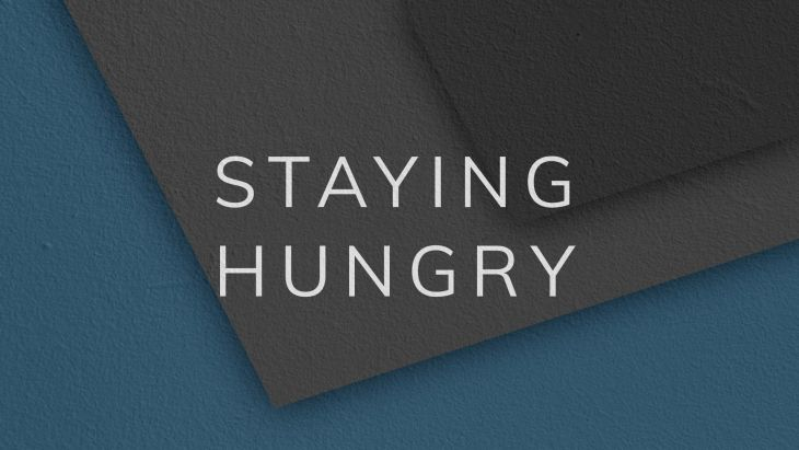 Illustration behind the words 'Staying Hungry'
