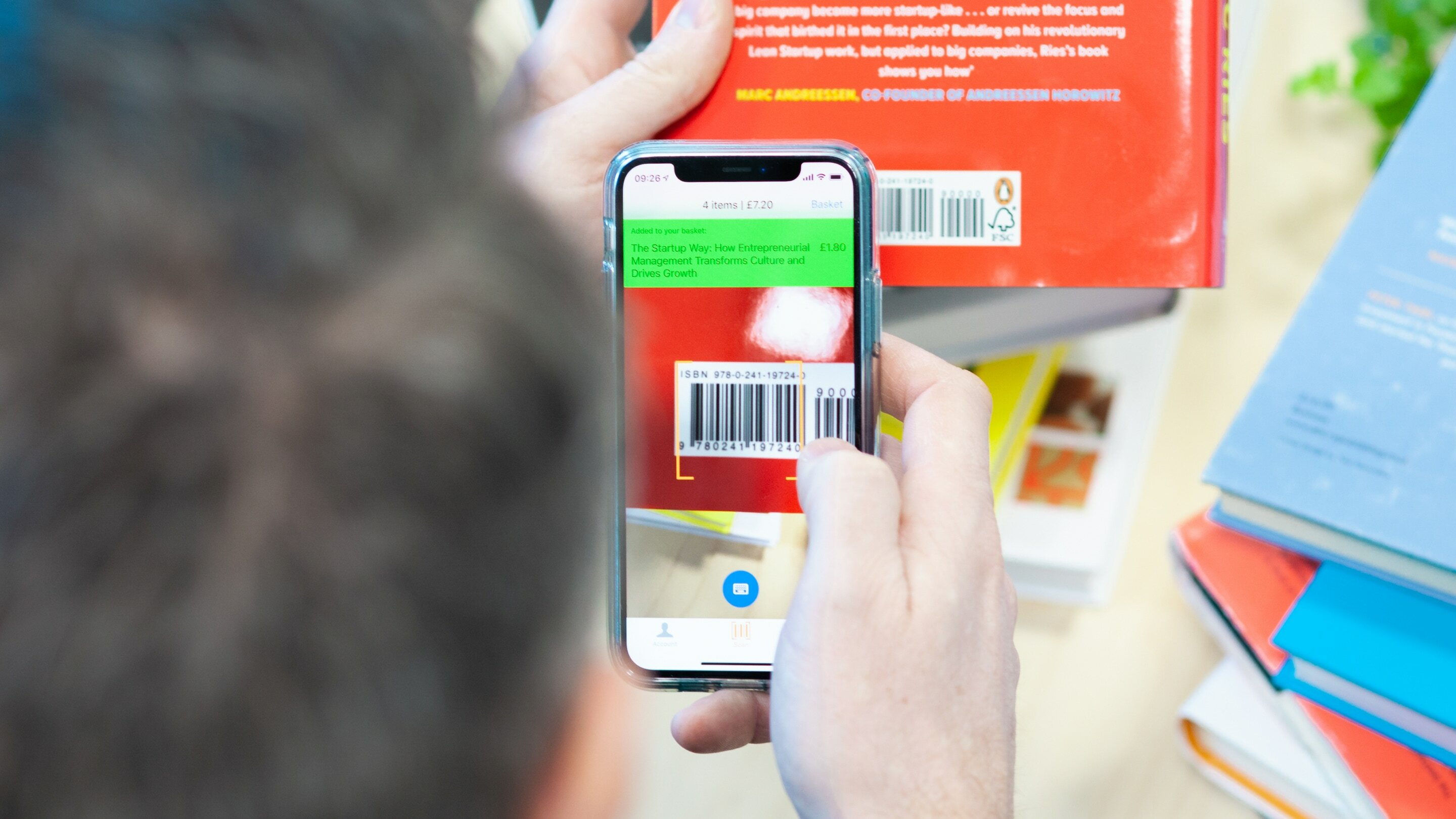 Ziffit app on iPhone being used to scan books